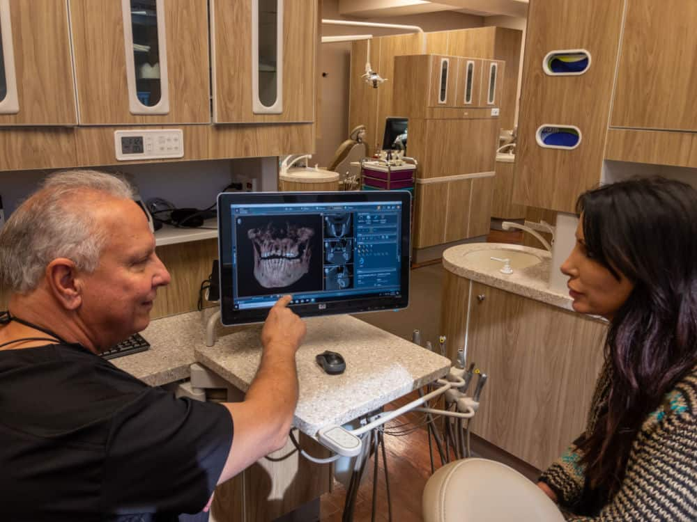 Dr. discussing dental implants with patient